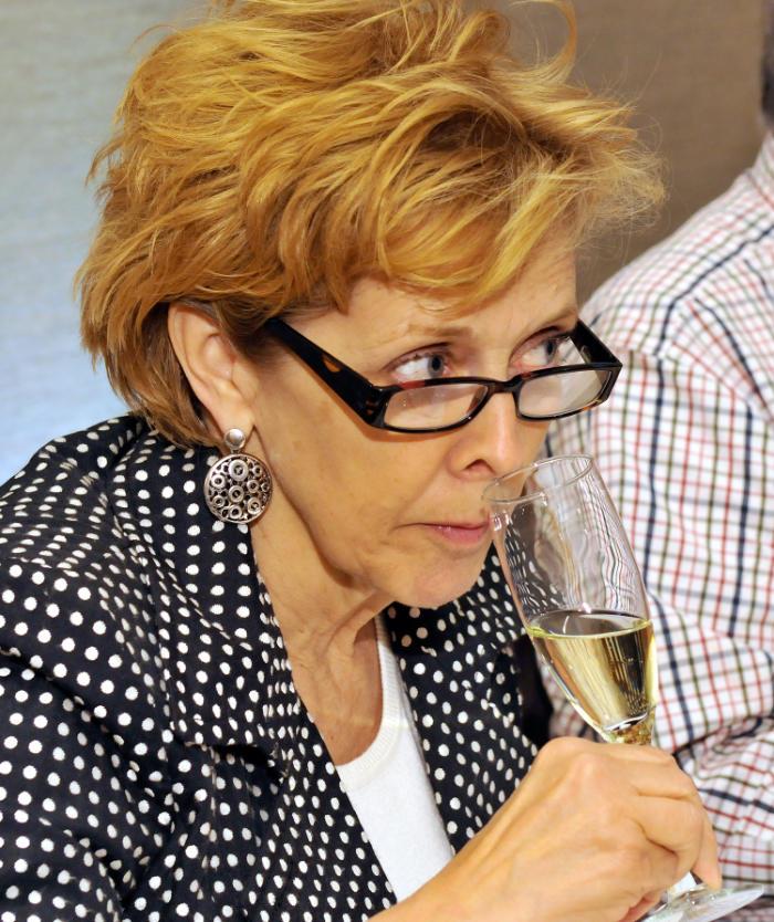 Liz Palmer Tasting Champagne